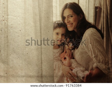 young mother with two her daughters. Photo in old color image style. - stock photo