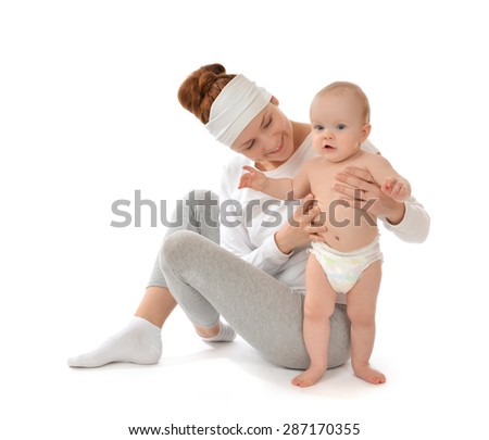 Young mother woman holding and hugging in her arms infant child baby kid girl smiling laughing on a white background - stock photo
