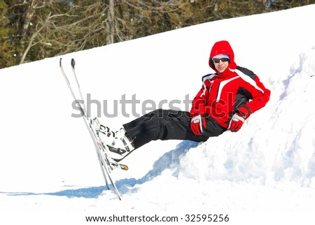 Young mountain-skier resting on the slope
