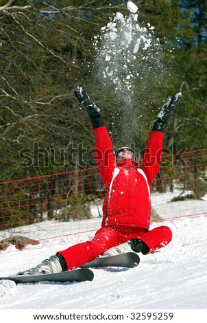 Young mountain-skier resting on the slope. - stock photo