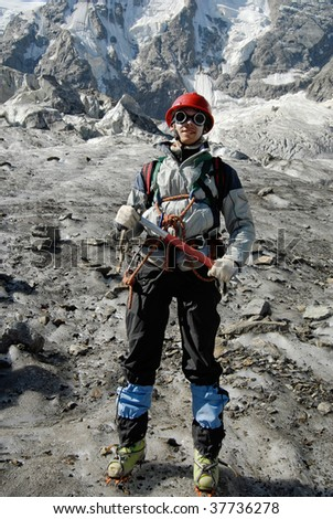 Young mountaineer is standing on a glacier during training courses