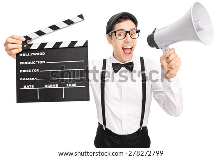 Young movie director with a black beret holding a clapperboard and speaking on a megaphone isolated on white background - stock photo