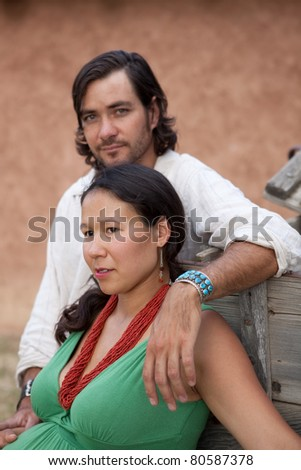 Young multicultural couple. Shallow DOF, focus is on woman's face. - stock photo