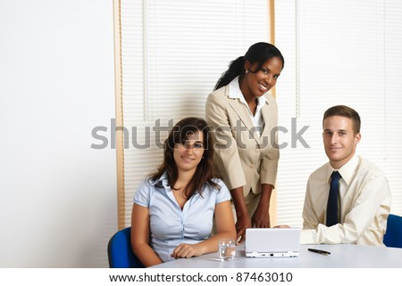 Young multinational working group of business people looking at the camera. - stock photo