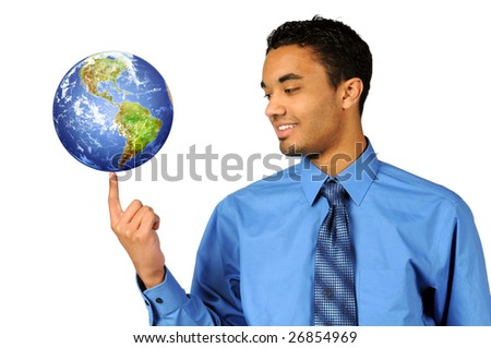 Young multiracial businessman balancing earth on tip of finger - stock photo