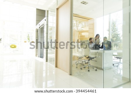 Young multiracial people in the office - stock photo