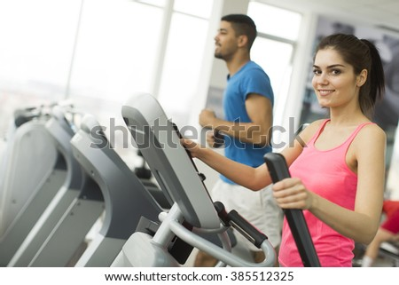 Young multiracial people training in the gym - stock photo