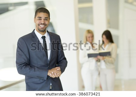 Young multiracial people working in the office - stock photo
