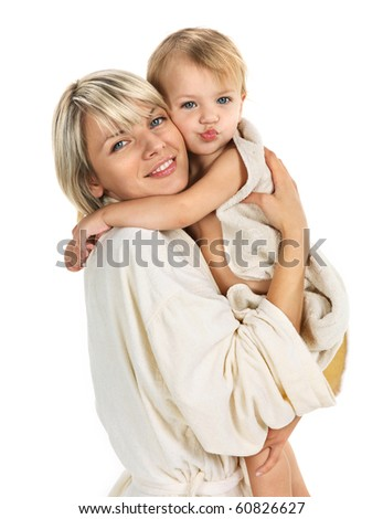 Young mum and beautiful small daughter after bathing sit in towels. Mother care. - stock photo