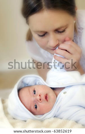 Young mum and her baby - stock photo