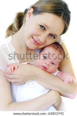 Young mum holding her baby - stock photo
