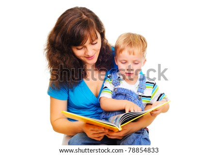 Young mum is reading a book with her cute son - stock photo