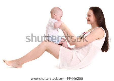 Young mum plays with the small son. A portrait on a white background. The child sits in a lap at mum, mum looks at the son. A horizontal.