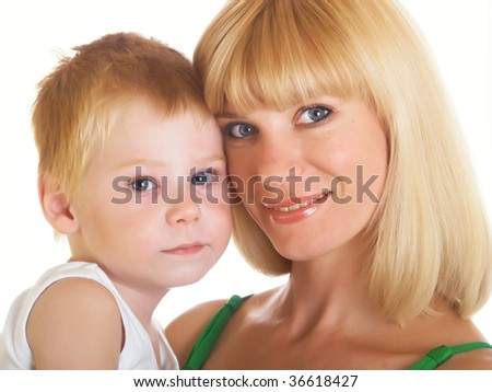 Young mum with the small son on a white background