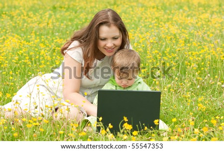 Young mum with the son on the nature - stock photo