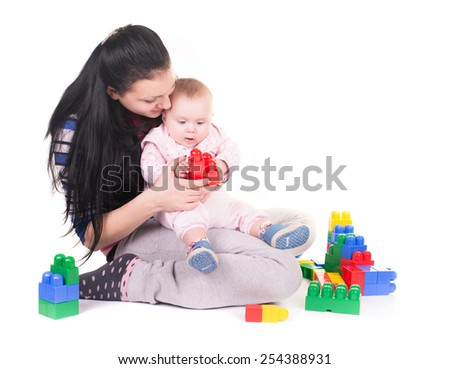 Young mummy and her kid isolated on white background. - stock photo