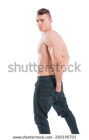 Young, muscular and shirtless male model flexing his muscles - stock photo