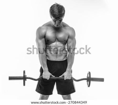 Young muscular guy in black shorts doing exercises with barbell. Isolated on white - stock photo