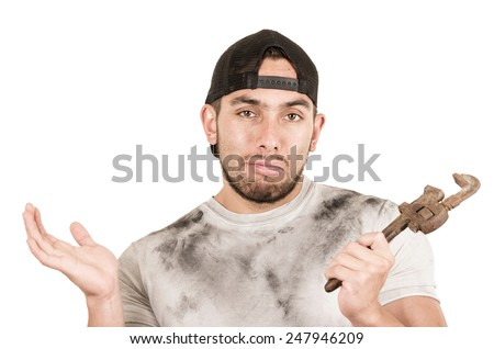young muscular latin construction worker holding a wrench isolated on white - stock photo