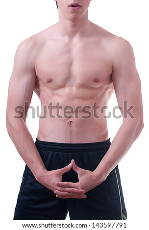 Young muscular man in front of a white background.