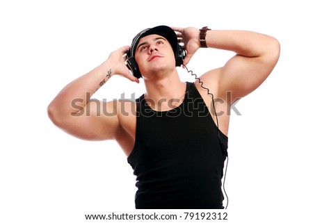 Young muscular man listen music isolated over white background
