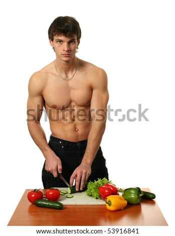 Young muscular man preparing salad isolated on white - stock photo