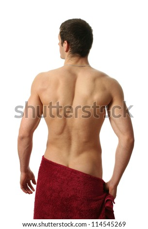 Young muscular man wrapped in a red towel isolated on white - stock photo