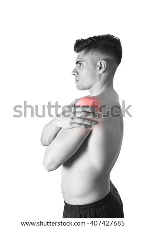 young muscular sport man holding sore shoulder with hand touching or massaging in workout stress body pain and health problem isolated black and white red spot injury - stock photo