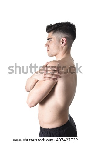 young muscular sport man holding sore shoulder with hand touching or massaging in workout stress body pain and health problem isolated on white background - stock photo