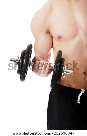 Young muscular sports man exercising with weights. - stock photo