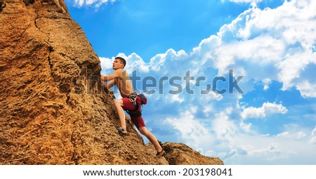 Young muscular tourist climbing on mountain - stock photo