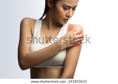young muscular woman with shoulder pain, on white background with clipping path  - stock photo