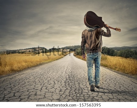 young musician on the road to success - stock photo