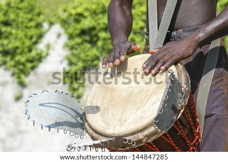 Young musician playing traditional african drum  - stock photo