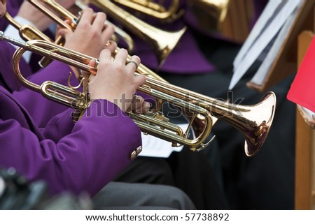 Young musicians are playing on trumpet
