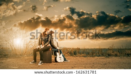 young musicians at fall countryside sunset - stock photo
