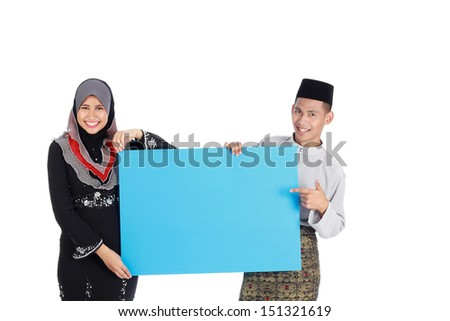 Young Muslim couple with copy space for your text - stock photo