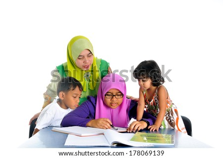 Young muslim girl studying with her mother and siblings, isolate on white background - stock photo