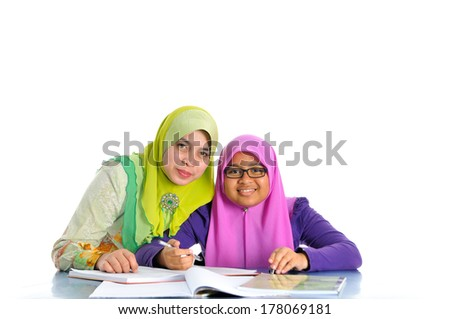 Young muslim girl studying with her mother, isolate on white background - stock photo
