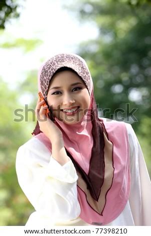 Young muslim girl  using cellphone