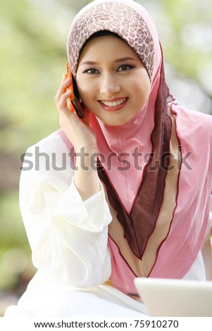 young muslim girl with cellphone