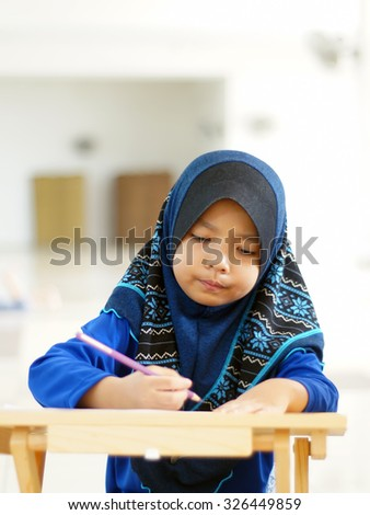 Young Muslim Kids study on the table. Muslimah Concept