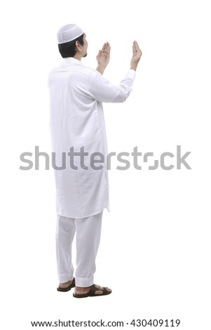 Young muslim man praying isolated over white background