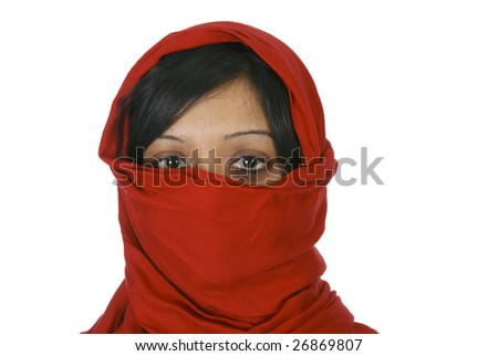 Young muslim woman covering her face - stock photo