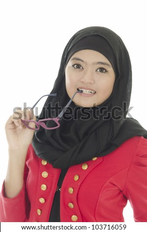 Young Muslim woman in head scarf. - stock photo