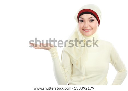 young muslim woman in head scarf presenting isolated over white background - stock photo