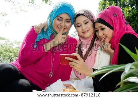 young muslim woman in head scarf take a photo with friends - stock photo