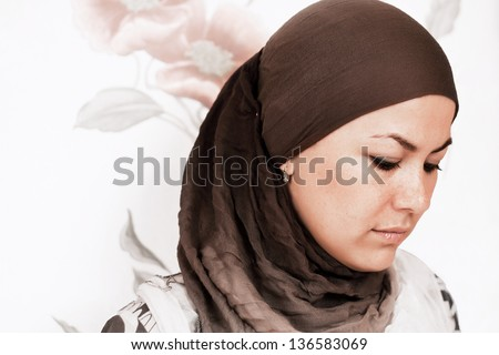 Young muslim woman wearing a hijab - stock photo