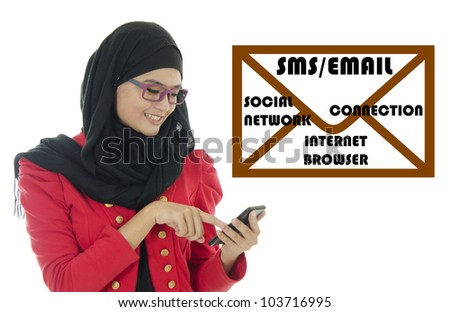 Young Muslim woman with phone while SMS and text with mail symbol. - stock photo