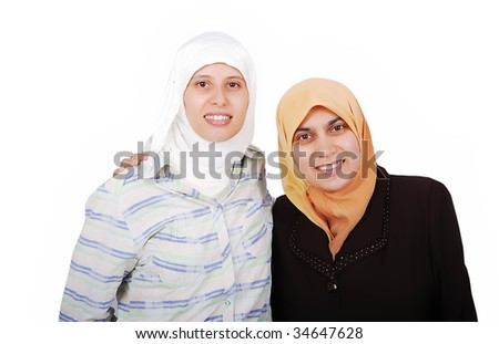 young muslim women in traditional clothes isolated - stock photo